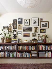 floating bookshelves a gallery wall and eclectic