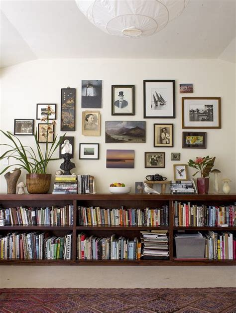 book selves floating bookshelves a gallery wall and eclectic