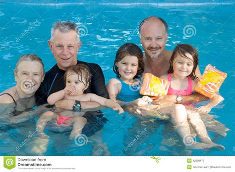 Family Swim Poll family at the swimming pool stock image image 12696177
