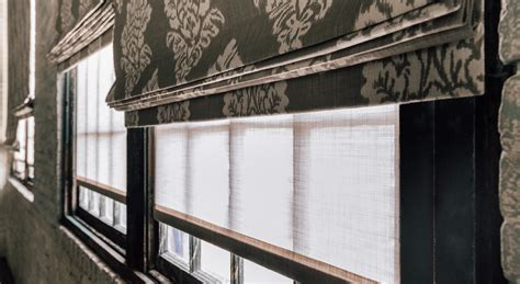 how mary layered roman blinds and curtains in her bedroom how to layer window treatment textures the shade store
