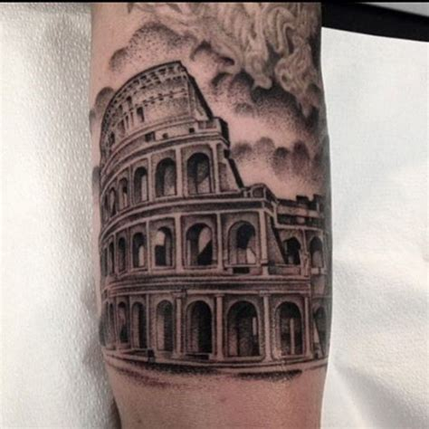 roman tattoo big black ink detailed forearm of ancient