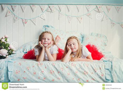 two girls in bed two little girls on the bed stock photo image 49330464