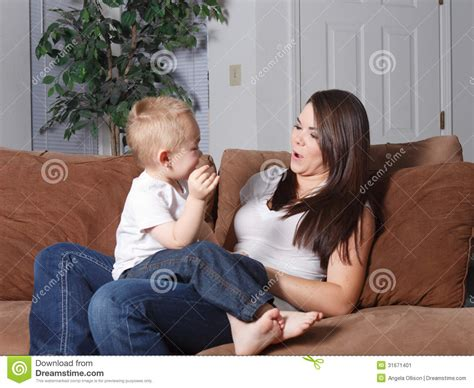 mom son couch mother and young son laughing and playing stock image