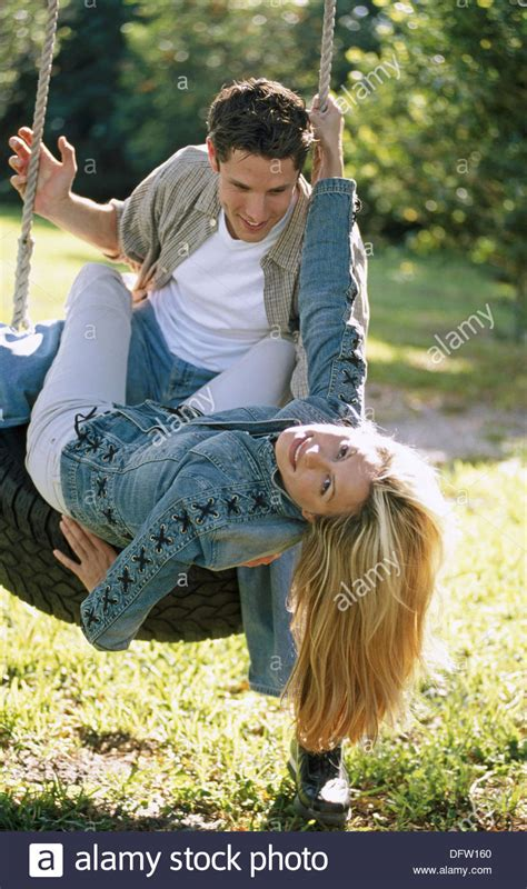 couples swing on a tire swing stock photo royalty free image