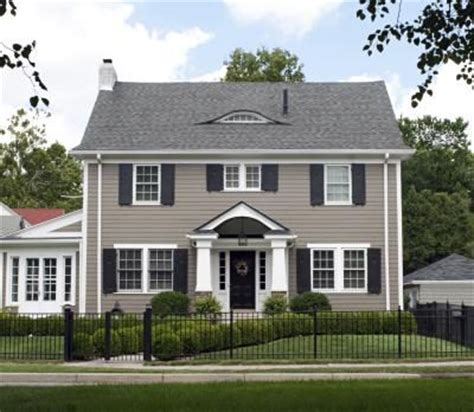 one way to tie in your exterior walls with a grey roof is to paint them a different shade of grey