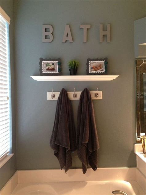 brown towels and white shelf using small personalized wall