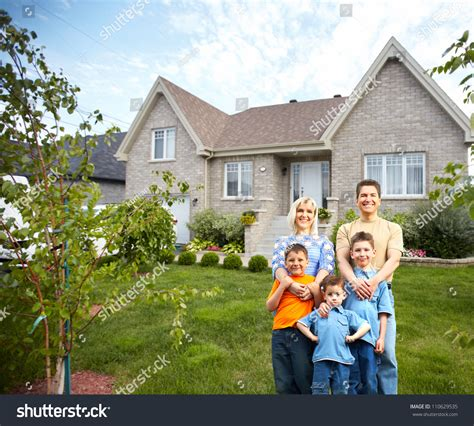 happy family near new house real stock photo 110629535
