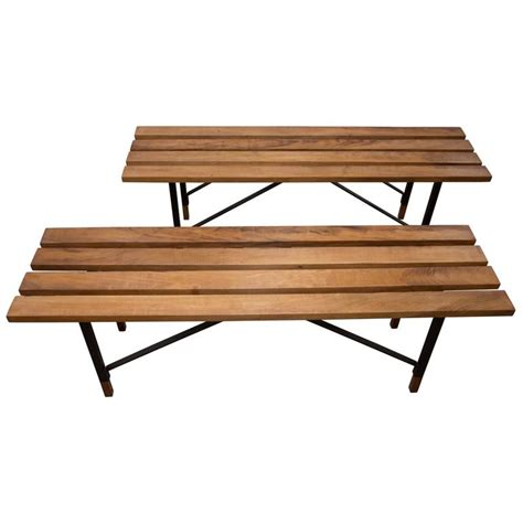 wood slat bench wood slat bench with black metal cross bar base and wood