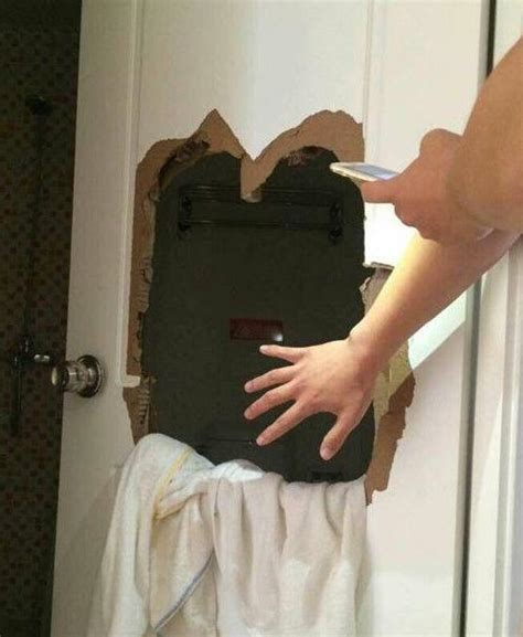 stuck in bathroom lovers locked inside hotel bathroom smash hole to escape