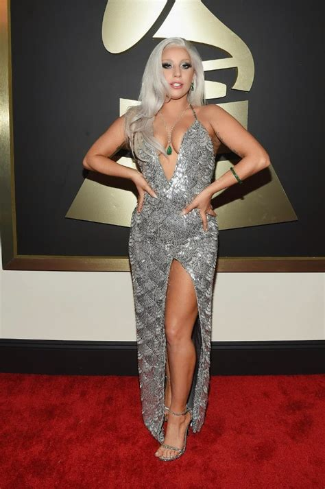 lady gaga accepts contemporary icon award in bra and lady gaga shows off legs and cleavage in a silver gown at
