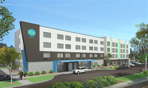 what hotel chain is comfort inn hilton targets young guests with new budget hotel chain