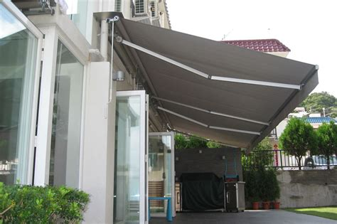 retractable awnings folding arm awnings conservatory