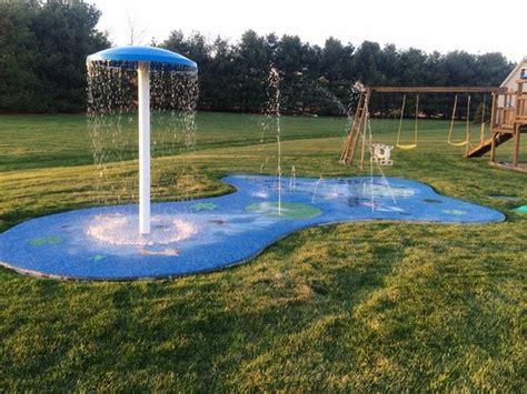 backyard sprinkler park backyard splash pad the perfect summer fun for the kids