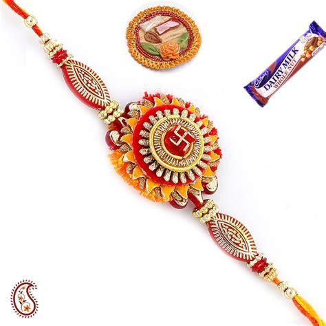 Handmade Rakhi Designs - buy swastik rakhi with handmade paper base