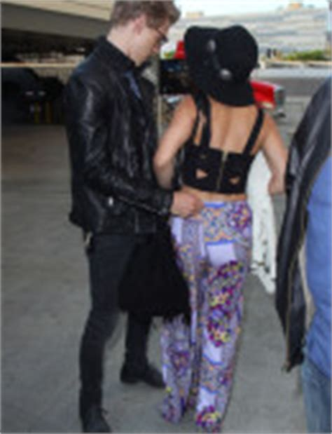 hudgens suffers a wardrobe malfunction at the