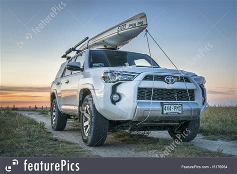 toyota 4runner suv with canoe on roof photo
