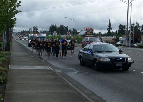 and carry in lynnwood edmonds mlt officers carry torch for special olympics