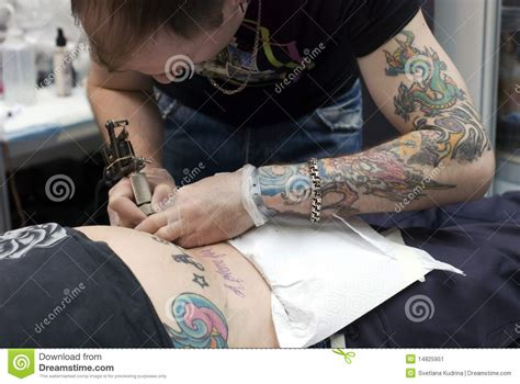 tattoo artist at work at saint petersburg tattoo f