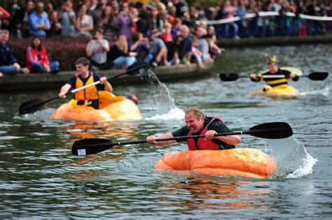 giant pumpkin boat giant pumpkin regatta sees paddlers race around lake in