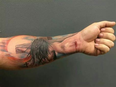 jesus tattoo using arm irti funny picture 8199 tags crazy jesus arm tattoo