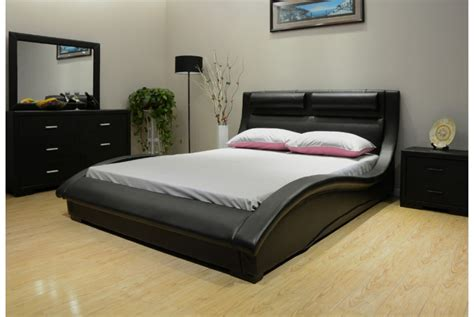 great looking bedroom with black huge headboard and
