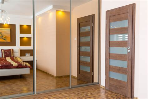 Installing Mirrored Closet Doors by 11 Ways To Make A Tiny Bedroom Feel Reliable Remodeler