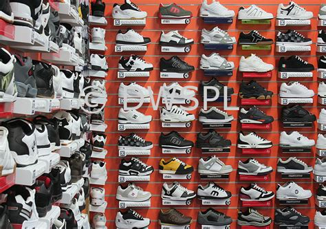 sport shoe shops view of shelves of sports shoes instore show display