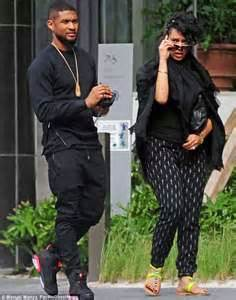 michelle grace harry usher displays his fit physique in a black vest on outing