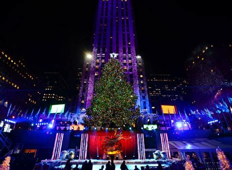 rockefeller center tree lights up city ny