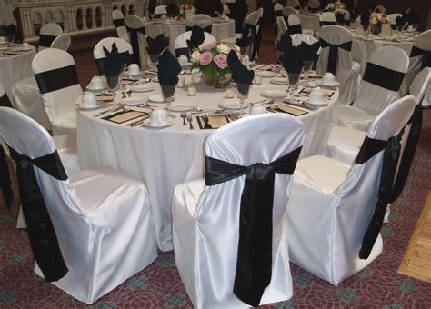 wedding tables and chairs cover black satin sashes chair covers unique floral