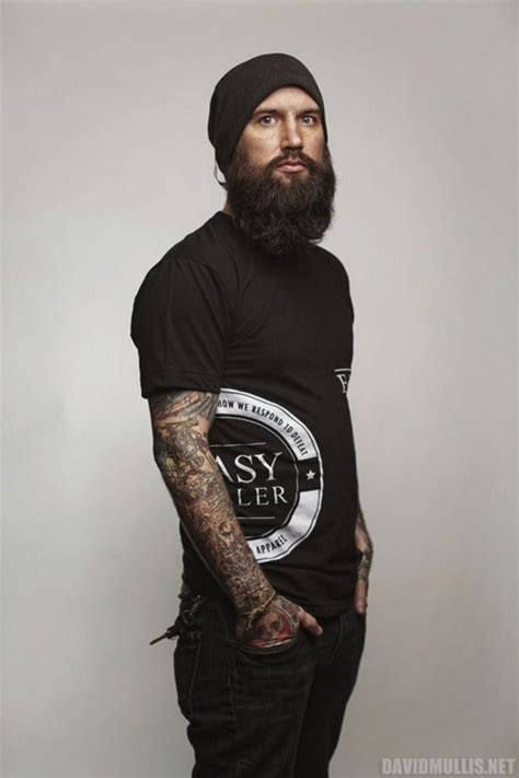 logo tattoo guy beaded man bearded tattooed man beard tattoo