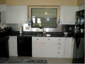 kitchen design black appliances with white cabinet and