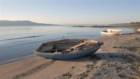 old boat on beach old dugout canoe by the riverbank southeast asia