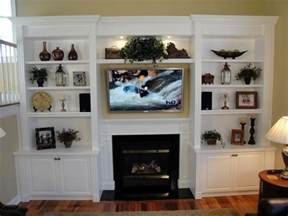built in shelves around the fireplace the tv this