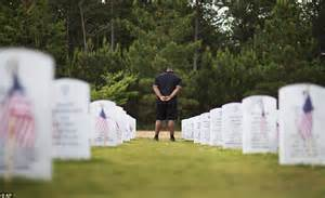 s day in the cemetery boy in marine lies next to his s grave at