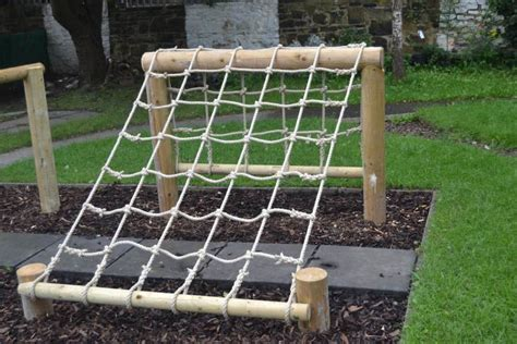 backyard climbing rope a scramble net as part of an outdoor obstacle course