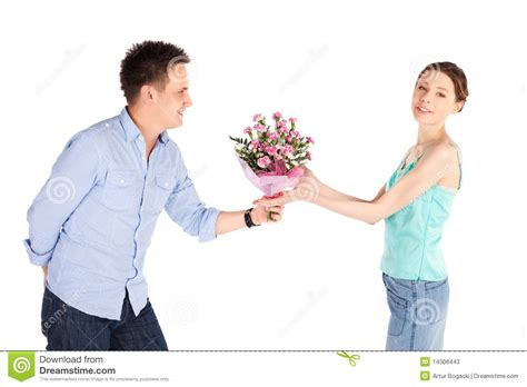 Casual Man Giving Flowers To Girlfriend Stock Photos