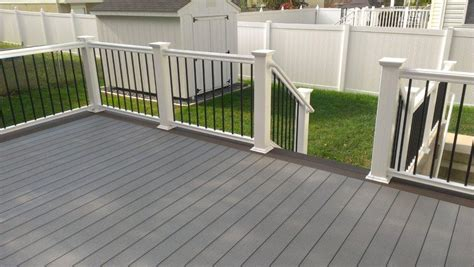 gray deck gray composite decking w a double walnut feature board