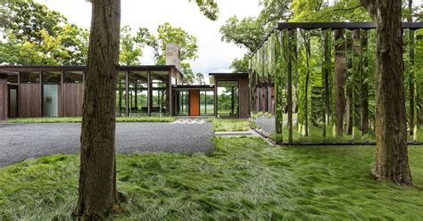 This Home Has A Mirrored Shed That Almost Blends Into Its