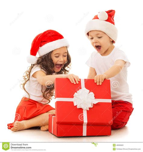 Happy Kids In Santa Hat Opening A Gift Box Stock Photo ... Happy Kids Opening Christmas Presents