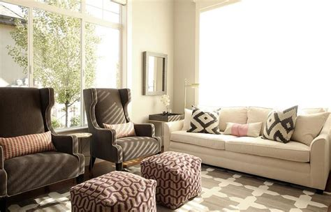 Window Treatments For A Bow Window white sofa with brown wingback chairs transitional