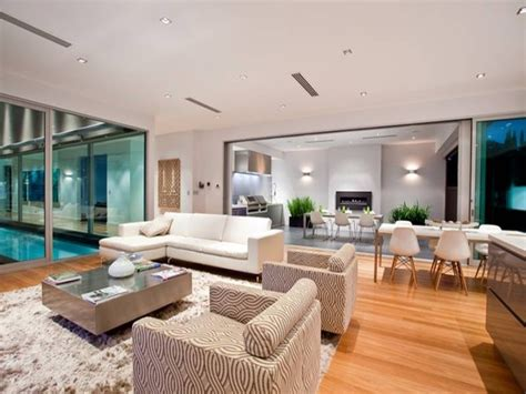 open plan living room using white colours with hardwood floor to ceiling windows living area