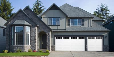 Ranch Panel Garage Door by Midland Doors Keep The Elements Out And Let Light In