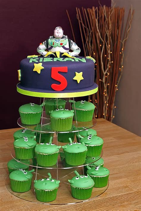 A Light Year Buzz Lightyear Cake With Alien Cupcakes