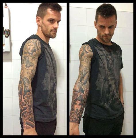 tattoo messi braccio foto tatuaggio spettacolare per un azzurro disegno