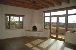 Kiva Style Fireplace - southwest style new stone home in new mexico quality construction