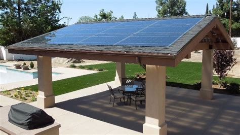 patio solar panels solar panels do duty as patio roof proud green home