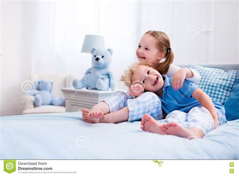 play in the bedroom kids playing in white bedroom stock photo image 73608741