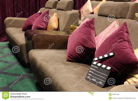 movie couch movie clapper board on soft sofa with cushions stock photo