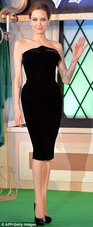 Two Terrible Black Dresses Two Different Places by And Ellie Fanning Attend Maleficent